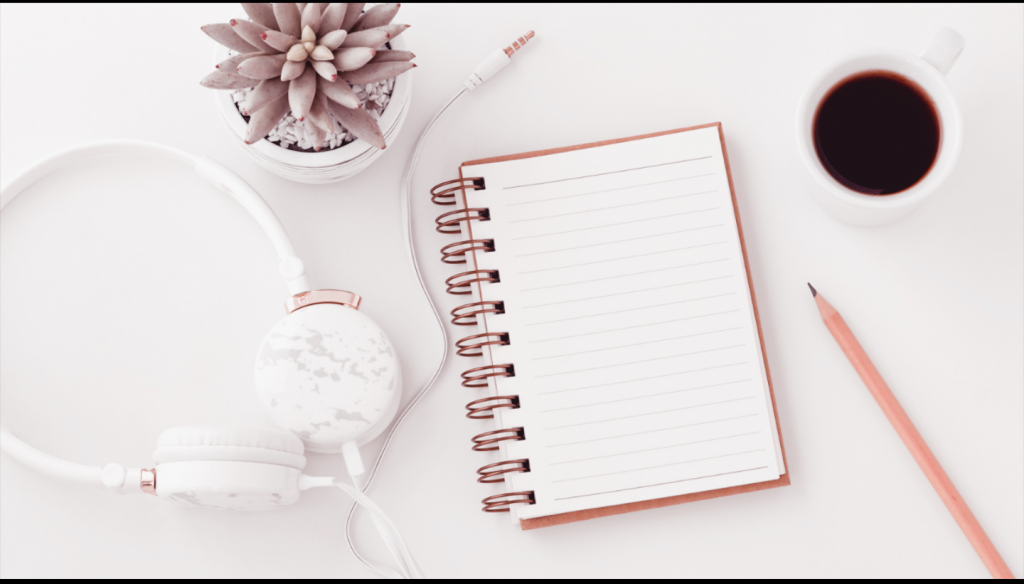 a picture of a notebook, pencil, headset, cup of coffee and a plant